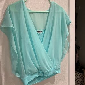 Light blue tank top with sheer overlay